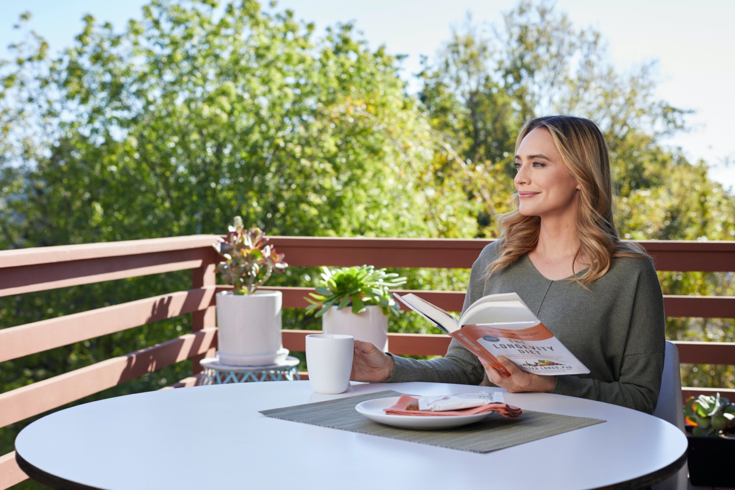 Woman reading outside - Health Retreat at home